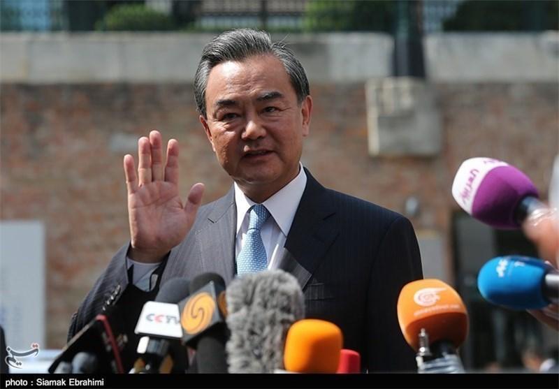 عکس، وزرای خارجه چین و فرانسه در جمع خبرنگاران